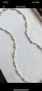 14k tin cup pearl necklace per jeweler retail value 400.00