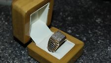 Mens diamond ring in two tone gold.