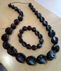 Conjunto de collar y pulsera negro