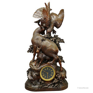 antique mantel clock with eagle and chamois family, ca. 1900