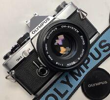 Olympus Om2 MD+objectif Zuiko 50mm f1,8.Très Bon état.Teste Pellicule,tout OK
