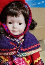 12 inch Porcelian Doll in Guatamalan outfit Brown Hair & Eyes with Bangs