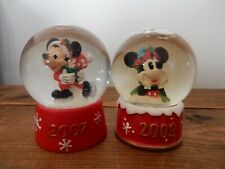 2 Disney-Mickey mini snowglobes marketed by JCPenny 2007 & 2009