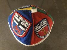 Vintage felt skull cap featuring German heraldic badges