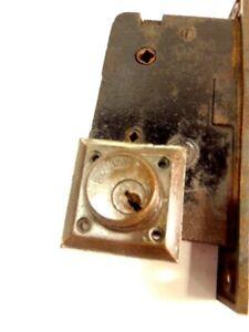 Vintage brass & steel door latch mechanism marked AHC; lock marked Reading