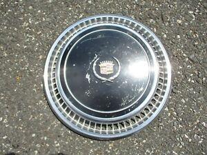 One genuine 1976 Cadillac Eldorado hubcap wheel cover black nice