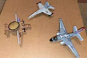 3 Diecast Miltary Planes. One Navy Brown Hawkeye And 2 unknown.