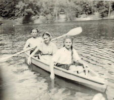 1950's Soviet photo Man and two young women in the boat with oars on the river