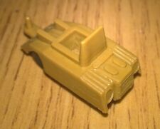 Small roughly N Gauge plastic carrier/artillery tractor 25mm long
