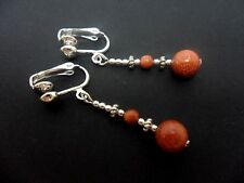 A PAIR OF DANGLY  GOLDSTONE SILVER PLATED CLIP ON   EARRINGS.