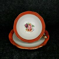 VINTAGE TEACUP AND SAUCER MADE IN JAPAN FLORAL WITH ORANGE AND GOLD TRIM