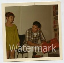 1970s color Square snapshot Photo tween girl   Man with Christmas gift
