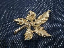 Really pretty brooch in gold tone metal in the form of a leaf with white stone