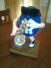 COOL DUDE M&M ON SAXOPHONE.MINT CONDITION.