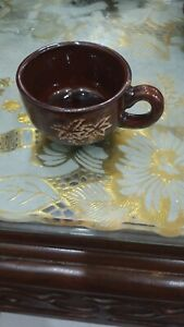 Tea cup, leaves design cup, brown used cup