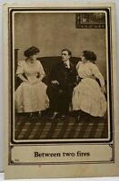Between Two Fires, Man with Two Women North Dakota Postcard D17