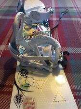 Women's snowboard with burton bindings, boots, ankle strap and travel bag