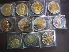 GROUP OF ELEVEN PRESIDENTIAL+U.S. DOUBLE-EAGLE GOLD ON SILVER-PLATED MEDALLIONS