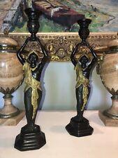 """Paire de bougeoirs """"aux nubiens"""" en bronze à double patine, vers 1950   Ht 41"""