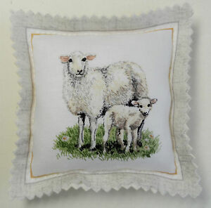 Handmade pin cushion. A Ewe and her lamb. 9cm x 9cm.