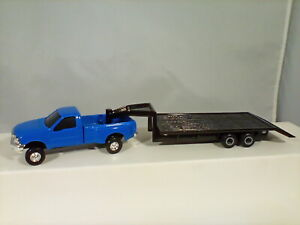 Ertl Blue Ford Dually and Black Equipment Trailer