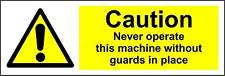 Caution never operate this machine without guards in place Safety sign