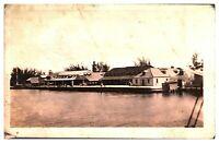 Antique military RPPC postcard Jamaica harbour scene with buildings