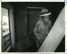 1987 Press Photo Butler Gibson holds door that was broken by a robber