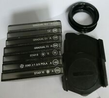 Seven Cokin Filters, two Filter Holders with Adapter Rings