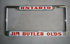 Ontario Jim Butler Oldsmobile Dealership License Plate Frame Metal Embossed Old