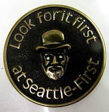 Vintage SEATTLE FIRST BANK Badge Emblem Plaque embossed brass man hat Seafirst
