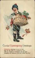 Thanksgiving Little Boy Turkey in Basket Snowstorm c1910 Postcard