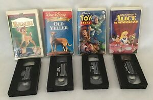 VHS WALT DISNEY CLASSICS. BAMBI, ALICE IN WONDERLAND, OLD YELLER. & TOY STORY