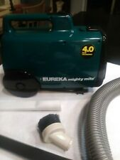 Eureka Mighty Mite canister vacuum cleaner and blower.