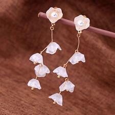 Boucles d'oreilles Clip On Doré Linéaire Long Fleur Muguet Blanc Resine J15