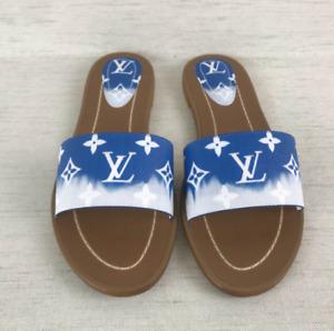 Louis Vuitton Escale Flat Mules Sandals