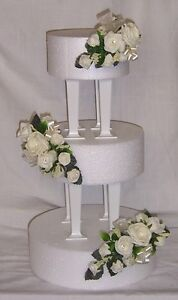wedding flowers ivory roses & ribbons with greenery cake 3 tier topper