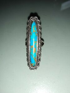 Unusual silver and turquoise ring