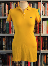 Lacoste polo Dress Size: 14  Color:  Yellow  Davanlay Small Kids Size