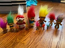 Multiple size trolls different holidays and hair colors