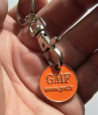 Ancien porte clé jeton de caddie GMF Assurance Mutuelle Orange.