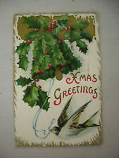 VINTAGE EMBOSSED CHRISTMAS POSTCARD BIRD WITH BLUE RIBBON AROUND HOLLY 1912