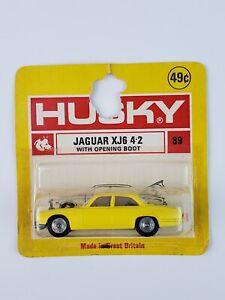 Vintage 1960's Husky Die cast Yellow Jaguar XJ6 4-2 Mint on Card Great Britain
