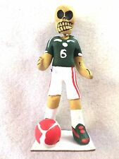 DAY OF THE DEAD  SKELETON  FIGURE OF SOCCOR PLAYER IN GREEN AND WHITE-   MEXICO