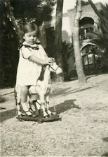 Photo ancienne vintage snapshot fillette little girl cheval de bois jouet 1930