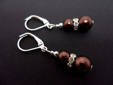 A PAIR OF DANGLY BROWN  GLASS PEARL  SILVER PLATED LEVERBACK HOOK EARRINGS.