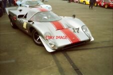 PHOTO  JONATHAN BAKER'S ATTRACTIVELY-LIVERIED LOLA T70 MK3B #SL76/138 IN THE MAR