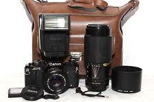 CANON AV-1 Black Reflex Analogica OBIETTIVO FD 50mm 1.8 + FD 70-210mm + FLASH *