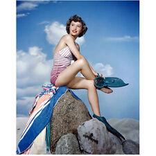 Barbara Stanwyck Seated on Beach Rock Ready to Take a Swim 8 x 10 inch photo