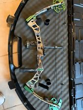 Fred Bear Instinct compound bow with True Glo 3 pin sight and stabilizer.